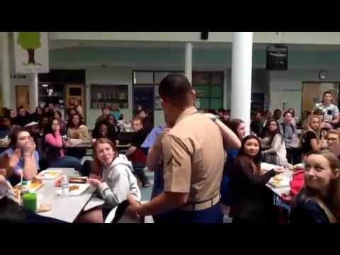 Marine brother surprises his little sister.