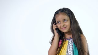 Beautiful Indian girl happily talking to her friend over a phone call - technology concept
