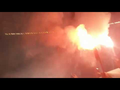 Insane soccer fans light flames inside stadium!    River plate south american cup match!