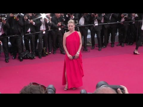Lady in Red Kate Moss stuns on the red carpet of Loving at the Cannes Film Festival 2016