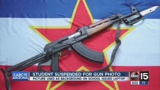 Student suspended for gขn photo