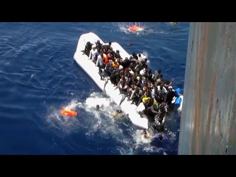 Migrants Flee Sinking Dinghy in Dramatic Footage