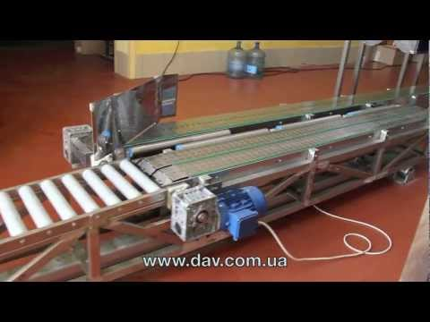 видео: Роликовыи конвеиер  для погрузки автомобилеи