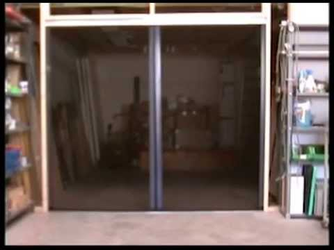 The magic roll screen door system youtube for Screen door with roll up screen
