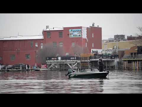 Multiple Fisherman Cruise Down Saginaw River In Bay City