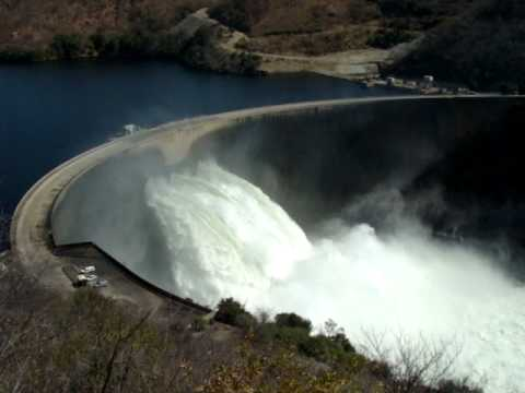 Kariba Dam wall 3 flood gates open.MPG