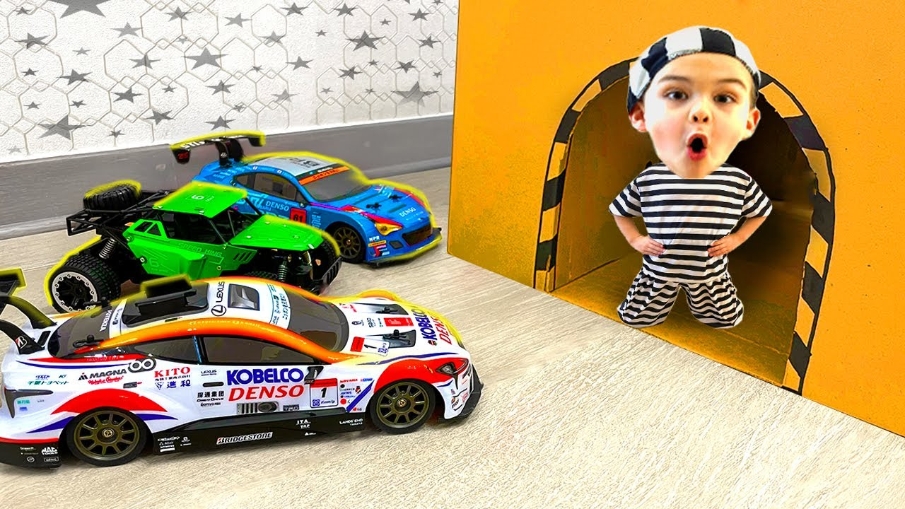 Dima plays with toy cars and saves a sport cars from a cave