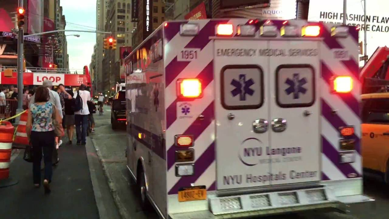 NYU LANGONE MEDICAL CENTER EMS AMBULANCE RESPONDING ON 7TH AVE  IN TIMES  SQUARE, MANHATTAN, NYC