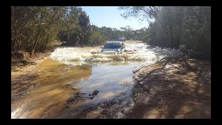 Water crossing gone wrong! Triton vs Hilux.