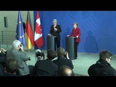 Harper, Merkel condemn Russia, ready for more sanctions