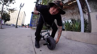Doing tricks on the worlds smallest bike.