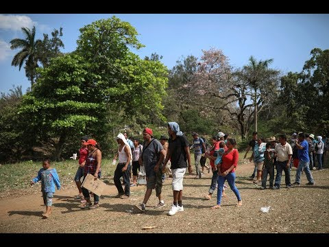 Dozens of migrants in the 'caravan' allowed to enter U.S. Many of the asylum-seekers allowed to enter so far are women and children., From YouTubeVideos