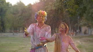 Cheerful young friends enjoying Holi festival celebrated in India - festive scene