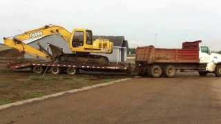 Duramax pulls Dump Truck and trailer out of the mud.