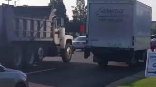 Mack R686 dump truck rolling coal