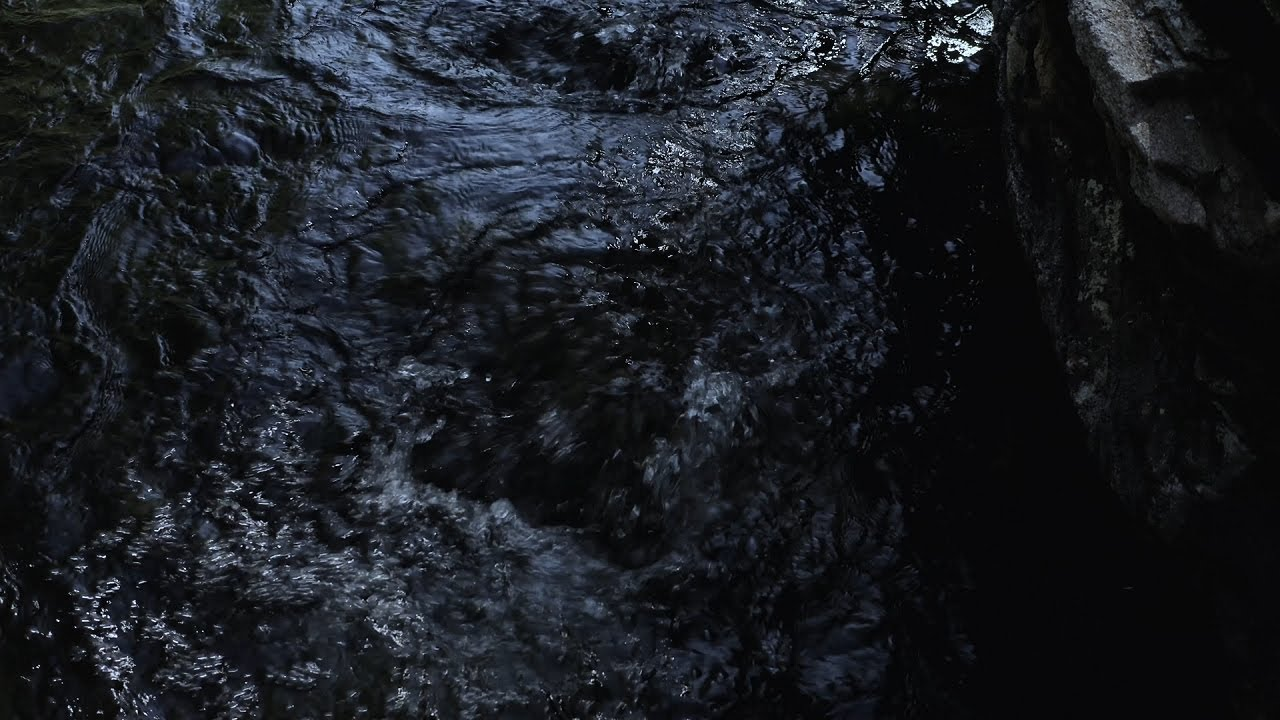 Bubbling water sound from an underground river exit