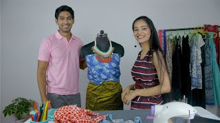 Indian fashion designers dressing up a mannequin with clothes and jewelry