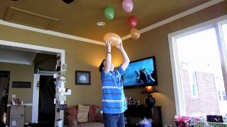Daniel demonstrates how to stick a balloon to your ceiling using st...