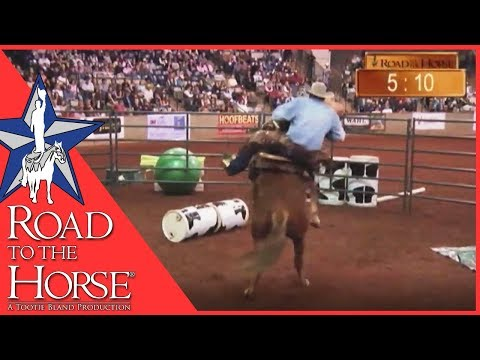 Must Watch  Pat Parelli famous buck off at Road to the Horse 2011