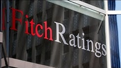 Fitch downgrades top banks