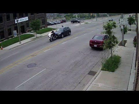 Driver hits Milwaukee police officer on motorcycle