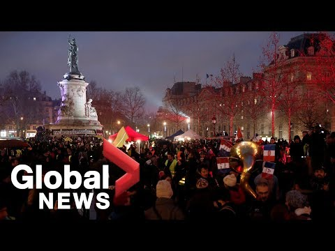 "Yellow vests stage a ""yellow night"" protest in Paris"