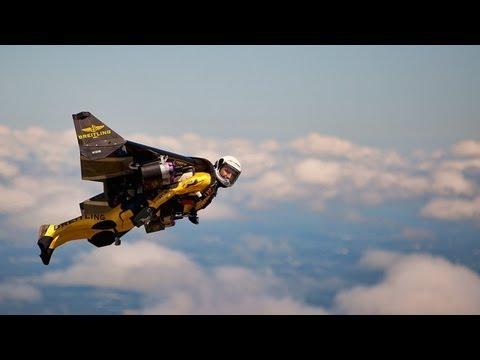 Jetman Yves Rossy flies alongside B-17 bomber plane
