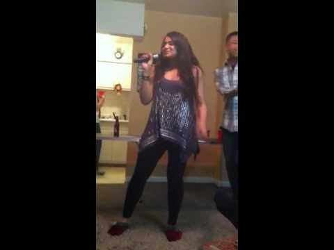 Tee attempting karaoke