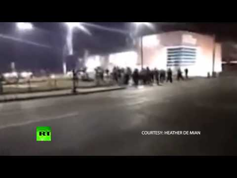 Moment Ferguson cops shot at caught on cam