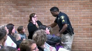 Teacher pushed to floor, handcuffed