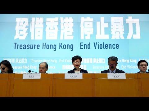 "Hong Kong officials answer questions on anti-mask law 這些""尖銳��題,香港特�政府官員一一回應"