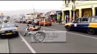 American bike rider rides bike very funnily on the street.