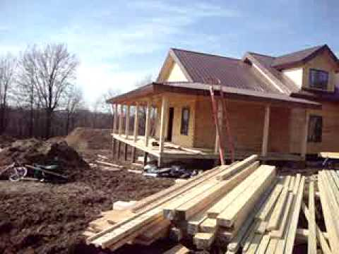 Coventy log home competed dry in wrap around porch with for House wrap prices