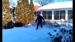 Chasing the dog through the backyard snow