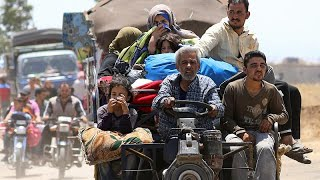Civilians flee fighting in southern Syria
