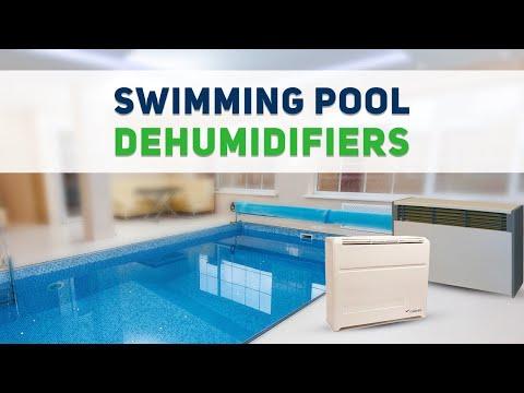 Swimming pool dehumidifier for reducing moisture around ...