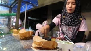 Cooking Thai Street Food: Street Food Vendors in Thailand. Shopping at a Thai Food Market