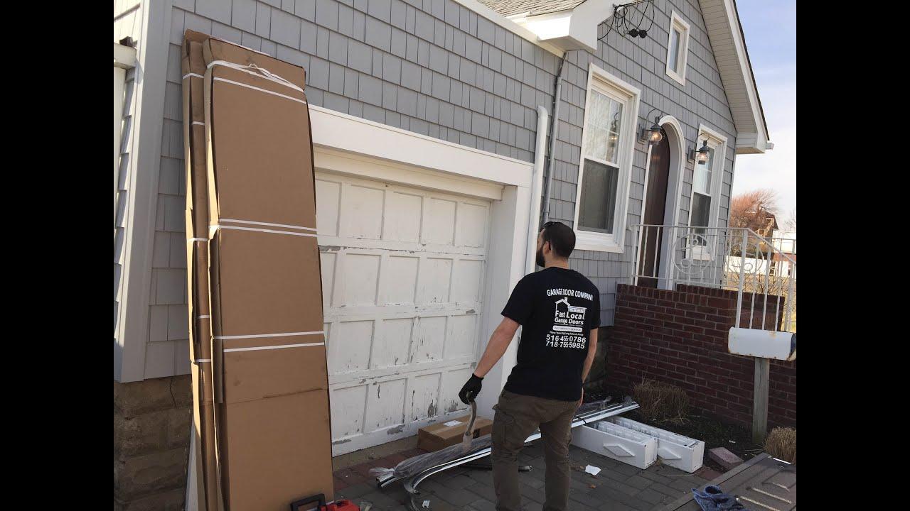Long Island Garage Door Team Installing New Door Opener In