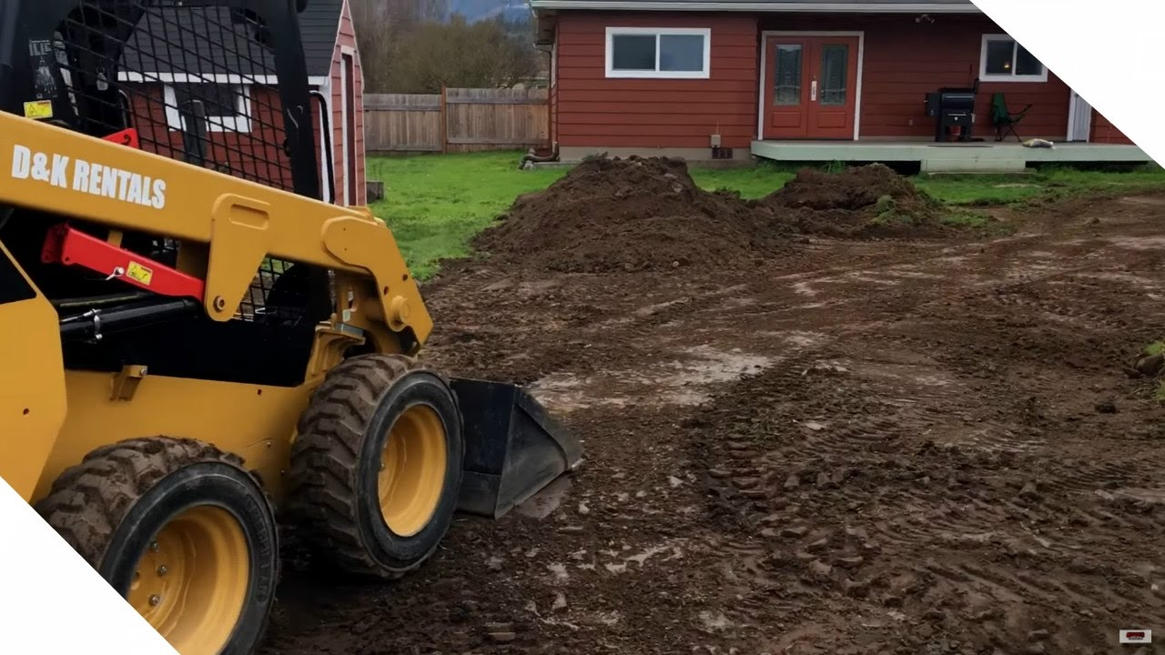 Grading The Yard With Cat Skid Steer