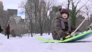 Sledding and skating in Central Park after vicious snow storm