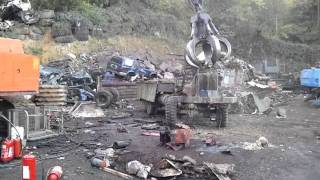 Old army truck ripped apart by crane before recycling...