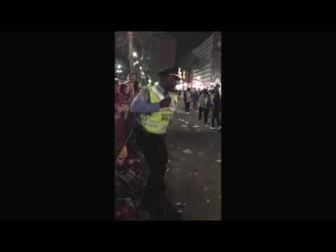 A dancing cop on the Mardi Gras parade route