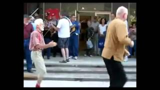 old men dancing bust a move and maybe their back