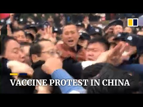 Chinese official appears to be beaten in protest over vaccine scandal