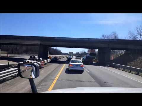 Car crashing into construction barrels during a BigRigTravels LIVE! broadcast