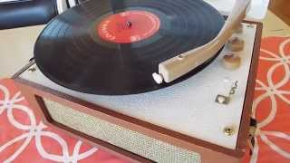 Columbia manual 4 speed record player playing a 33.3 RPM, LP record