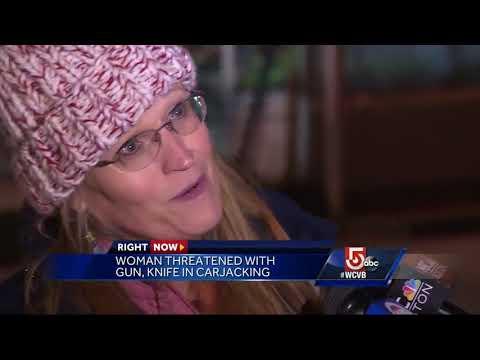 Woman threatened with gun, knife in carjacking