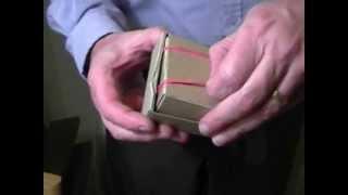 Münze in eine Magic Box Trick