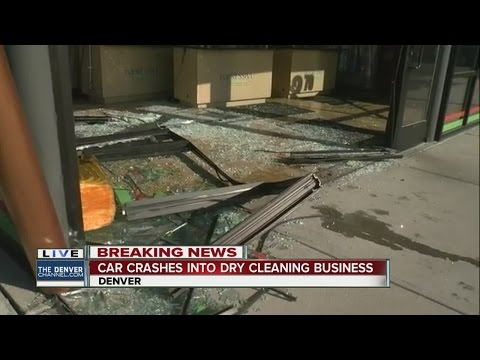 SUV slams into dry cleaners