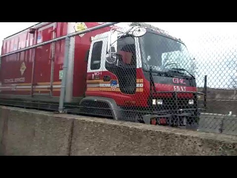 FDNY Technical Services Box Truck Passing By Over The RFK Triborough Bridge In East Harlem, NYC